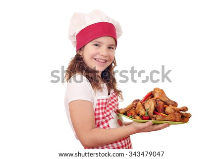 happy little girl cook with roasted chicken drumsticks - stock photo