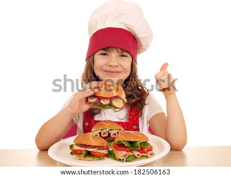happy little girl cook with sandwich and thumb up - stock photo