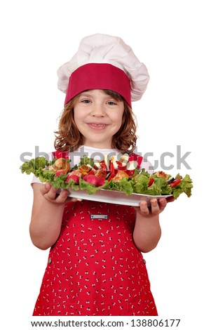 happy little girl cook with stuffed chicken meat and salad - stock photo