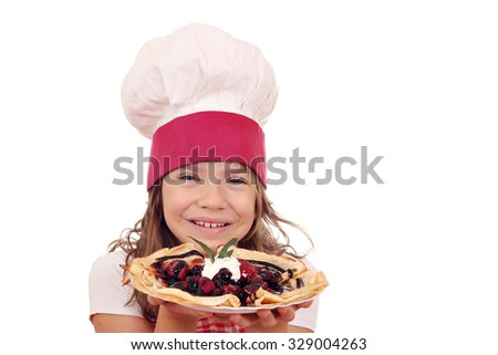 happy little girl cook with sweet crepes portrait - stock photo
