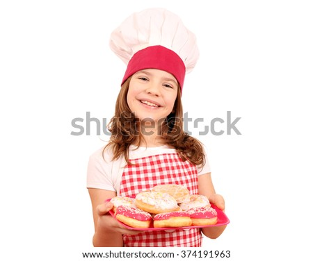 happy little girl cook with sweet donuts on plate - stock photo