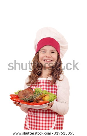 happy little girl cook with turkey drumstick and salad on dish - stock photo