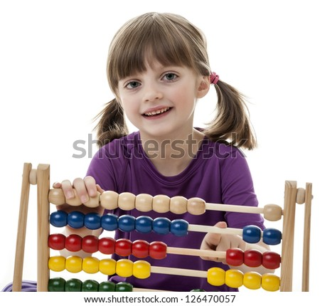 happy little girl counting with abacus - white background - stock photo