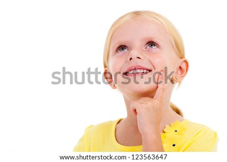 happy little girl daydreaming on white - stock photo