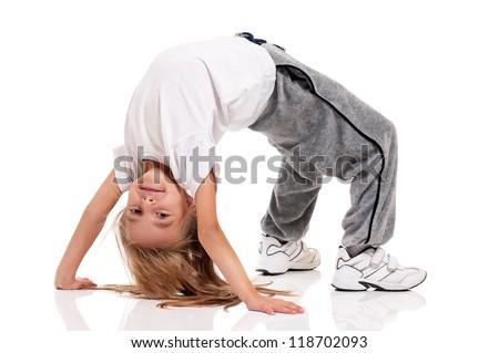 Happy little girl doing gymnastics isolated on white background - stock photo