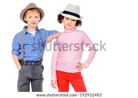 Happy little girl embracing a cute boy. Children. Fashion shot. Isolated over white. - stock photo