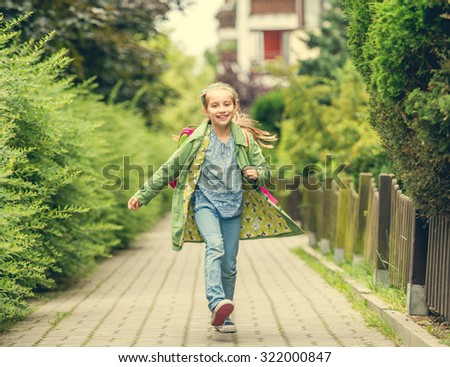 happy little girl go home from school - stock photo