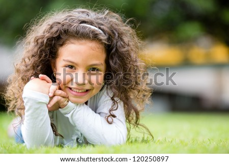 Happy little girl having fun at the park - stock photo