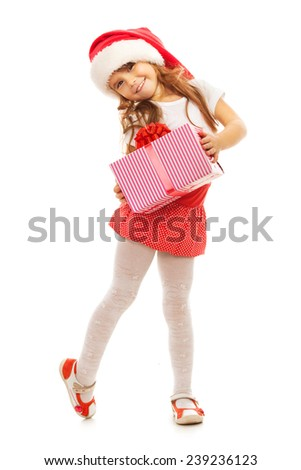 Happy little girl holding Christmas gift box in hand. Isolated on white background. Holidays, christmas, new year, x-mas concept. - stock photo