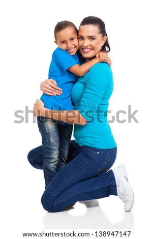 happy little girl hugging her mother on white background - stock photo