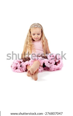 Happy little girl in pink tutu skirt and diadem isolated on a white background - stock photo