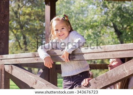 Happy little girl in the park. Autumn season. - stock photo