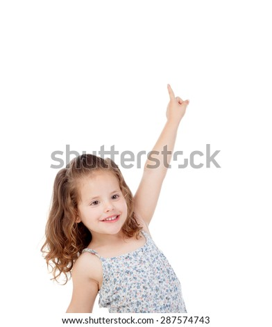 Happy little girl indicating something with the finger isolated on a white background - stock photo