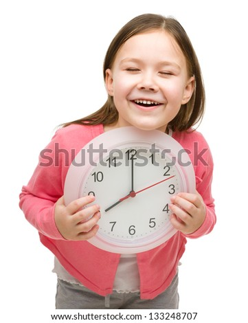 Happy little girl is holding big clock showing eight, isolated over white - stock photo