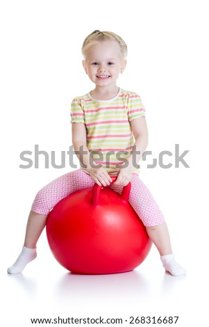 happy little girl jumping on bouncing ball. Isolated on white. - stock photo