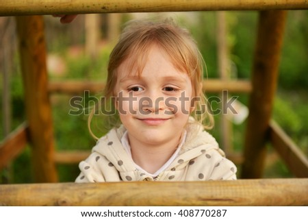 Happy little girl playing on outdoor playground - stock photo