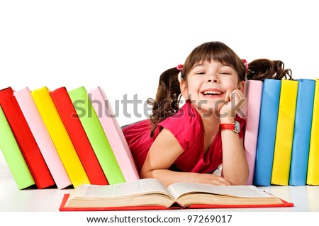 Happy little girl reading a book on the floor. Isolated on white background - stock photo