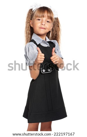 Happy little girl. Smiling little girl with backpack showing her thumbs up, isolated on white background. - stock photo