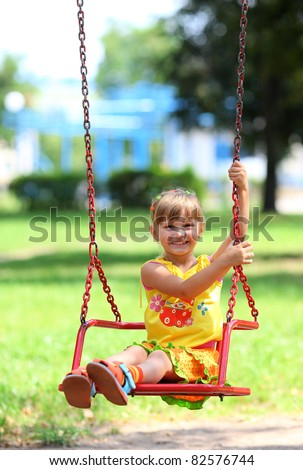 Happy Little Girl Smiling on Swing - stock photo