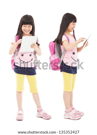 happy little girl student touching tablet pc - stock photo