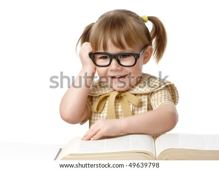 Happy little girl surrounded by books wearing black glasses, back to school concept, isolated over white - stock photo