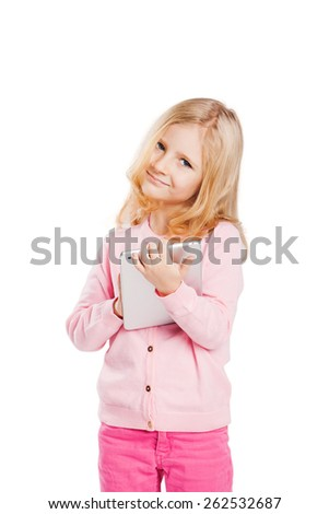 Happy little girl using tablet computer. Isolated on white - stock photo