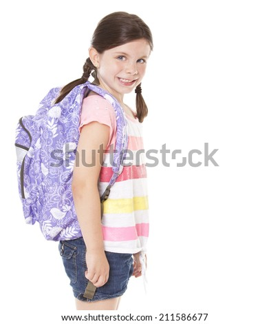 Happy little girl with backpack isolated on white - stock photo