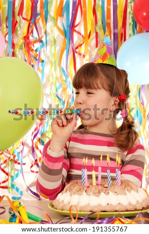 happy little girl with balloons and birthday cake - stock photo