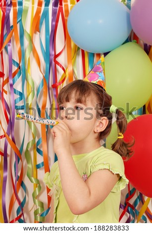 happy little girl with balloons and trumpet birthday - stock photo