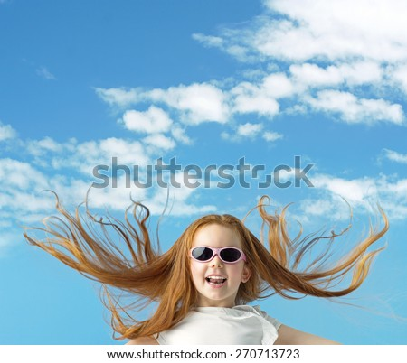Happy little girl with big sunglasses - stock photo