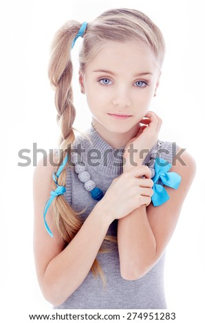 Happy little girl with blond hair. Isolated on white background - stock photo