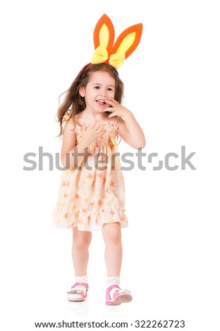 Happy little girl with bunny ears over white background. - stock photo