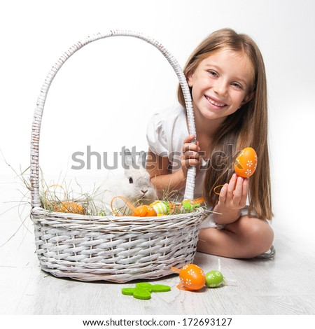 happy little girl with bunny in a basket. Easter photo - stock photo