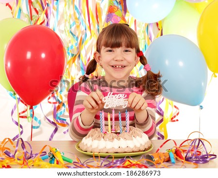 happy little girl with cake and balloons birthday party - stock photo