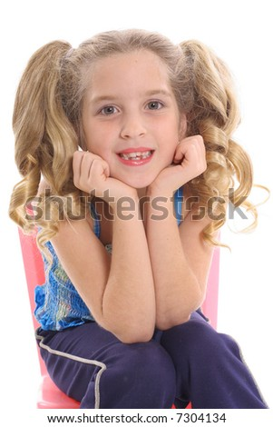 happy little girl with curly pig tails - stock photo