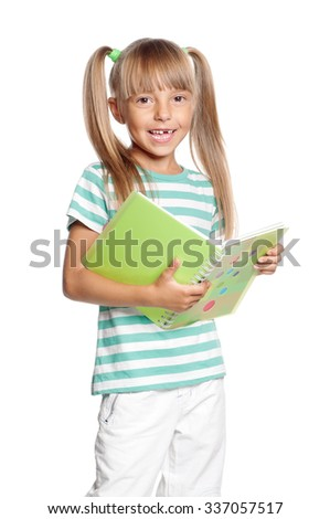 Happy little girl with exercise book isolated on white background - stock photo