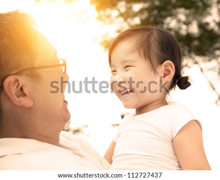happy little girl with father - stock photo