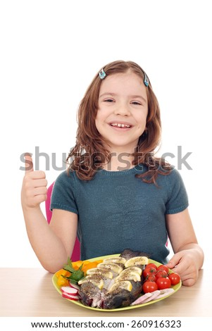 happy little girl with fish and thumb up - stock photo