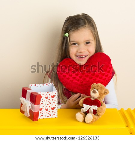 Happy Little Girl with Her Valentine Day Presents - stock photo