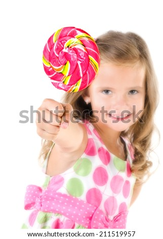 Happy little girl with lollipop foreground isolated on a white - stock photo