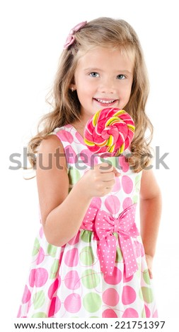 Happy little girl with lollipop isolated on a white background - stock photo