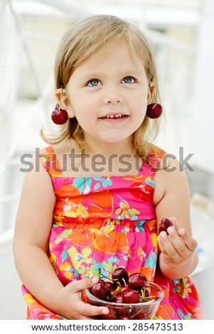 happy little girl with merry on her ears - stock photo