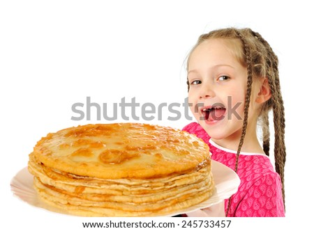 Happy little girl with tasty pancakes - stock photo