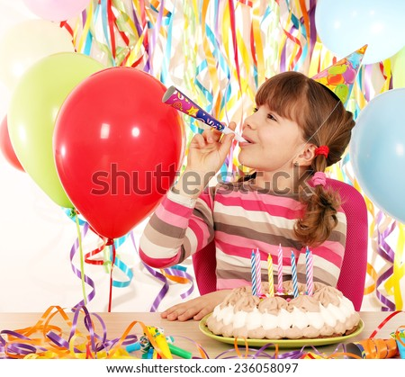 happy little girl with trumpet and birthday cake - stock photo