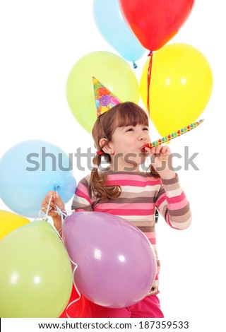 happy little girl with trumpet hat and balloons birthday party - stock photo