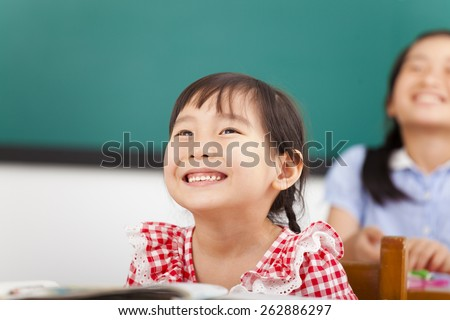 happy little girls in the classroom - stock photo