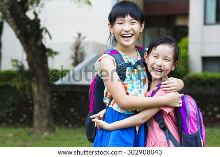 happy little girls with classmates having fun at the School  - stock photo