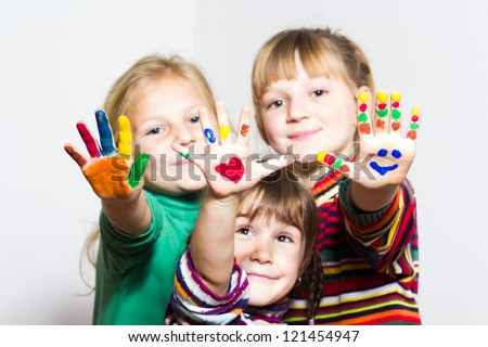 Happy little girls with painted hands - stock photo