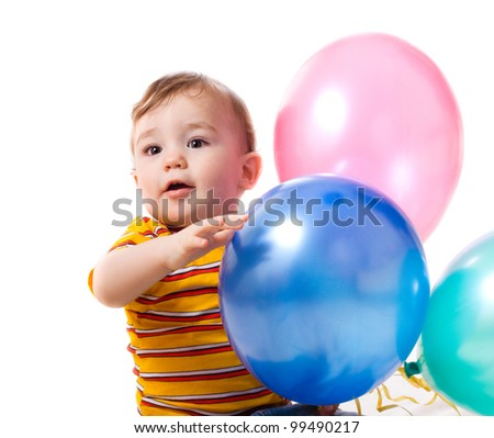 Happy little kid with baloons - stock photo