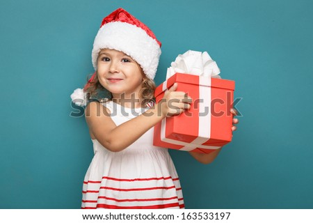Happy little smiling girl  with  christmas gift  box. - stock photo